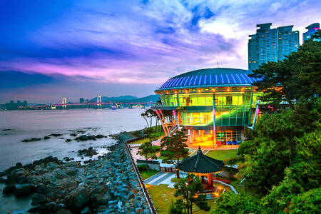 Photo for Dongbaek island with Nurimaru APEC House and Gwangan bridge at sunset in Busan,South Korea - Royalty Free Image