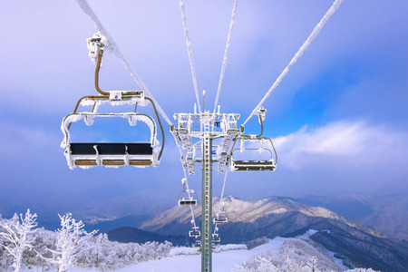 Photo for Ski chair lift is covered by snow in winter, Korea. - Royalty Free Image