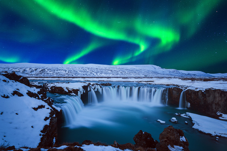 Photo for Northern Light, Aurora borealis at Godafoss waterfall in winter, Iceland. - Royalty Free Image