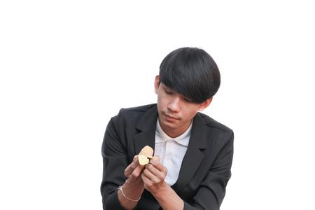 handsome man eating a fresh orange on white background