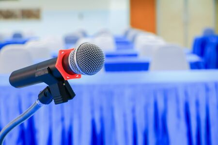 microphone wireless on a stand in interior meeting room seminar empty conference background, Select focus with shallow depth of field.