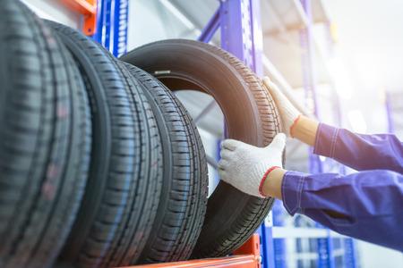 Foto de Tires in a tire store, Spare tire car, Seasonal tire change, Car maintenance and service center. Vehicle tire repair and replacement equipment. - Imagen libre de derechos