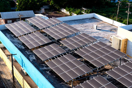 Photo pour Solar panels or Solar cells on building rooftop or terrace with sun light, Can saving energy. Sun or renewable or Clean energy. - image libre de droit