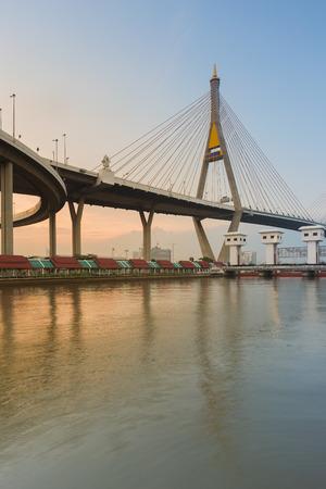 Suspension Bridge cross over Bangkok main river during sunset, Thailand