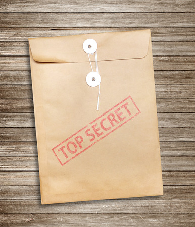 Top Secret package on wood background