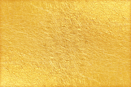 Foto de Shiny yellow leaf gold foil texture background - Imagen libre de derechos