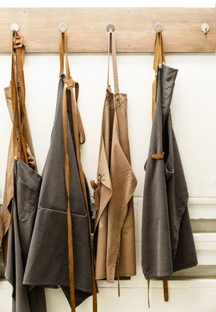 apron hanging on white wall