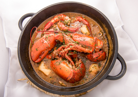 Photo for Traditional spanish paella rice with lobster and meat on pan - Royalty Free Image