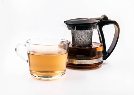 Photo for Teapot and cup with tea  on white background - Royalty Free Image