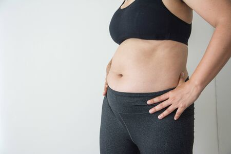 Photo pour Chubby woman with belly fat on white background - image libre de droit