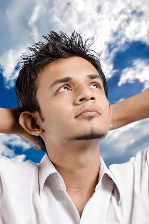 Man on white background looking at sky and think something positively
