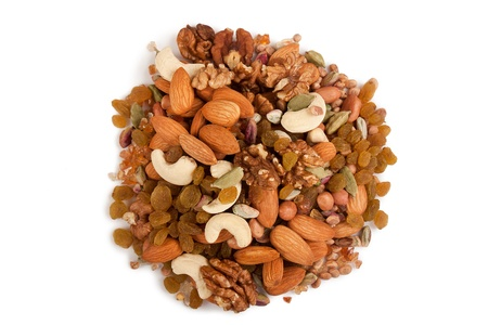 Pile of mix collection of dry fruits isolated over white