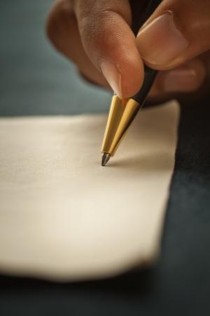 Photo pour Close-up shot of a man s hand, holding a pen  - image libre de droit