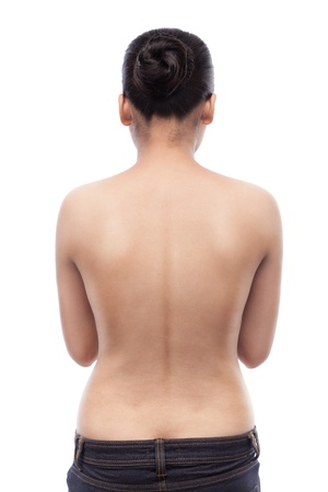 Young indian woman showing her smooth skinned back and wearing blue jeans, isolated on white