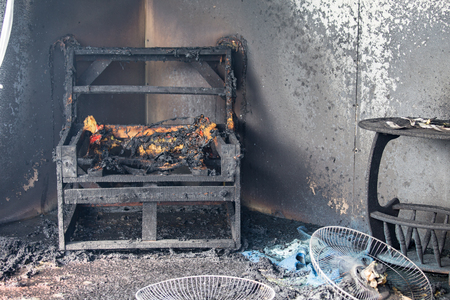 Photo pour chair and furniture in house after burned by fire with smoke and dust in burn scene of arson investigation course - image libre de droit