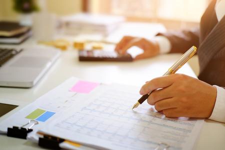 Photo pour Certified public accountant, Man working on spreadsheet document financial data. - image libre de droit