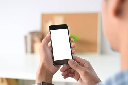 Photo for Man hands holding smart phone with blank copy space screen for your text message or information content, male reading text message on telephone during in office desk urban setting. - Royalty Free Image