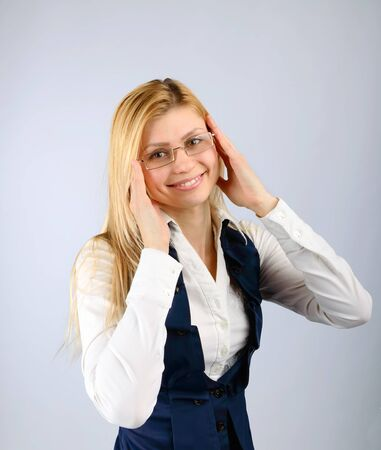Concept of vision correction. Smiling girl in glasses