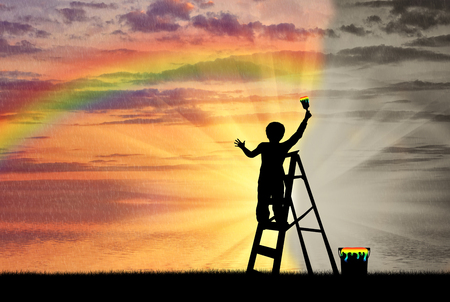 Photo for Child paints the seascape with a rainbow instead of gray image - Royalty Free Image