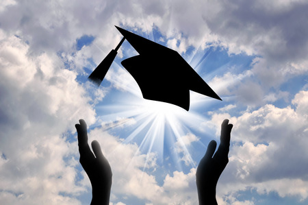 Photo for Hands graduate cap throw up in sky. concept of education - Royalty Free Image
