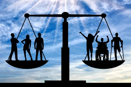 Photo pour Persons with disabilities have equal rights in the balance with healthy people. Concept of social equality of disabled people in society - image libre de droit