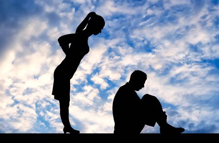 Photo pour Workplace bullying concept. Silhouette of a frightened male worker sitting on the floor and a female boss from behind scolding him - image libre de droit