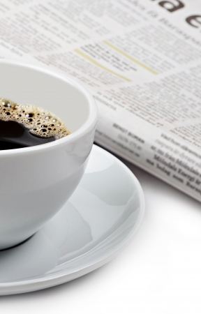 A cup of good hot coffee and a newspaper