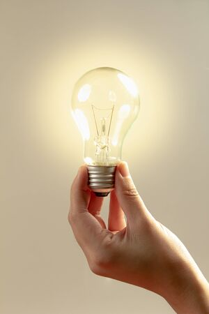 Photo for Hand hold a lightbulb,Innovation or  creative concept. - Royalty Free Image