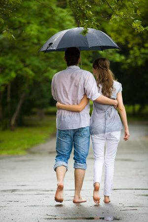 Rear backs of couple embracing each other in the park