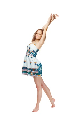 Portrait of a young girl in sundress stretching herself