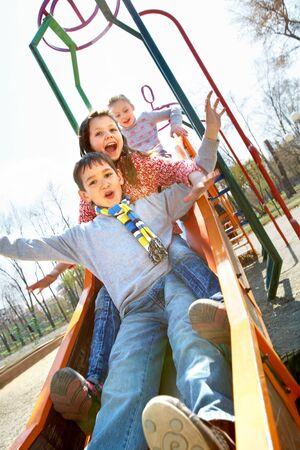 Portrait of happy children having fun outside