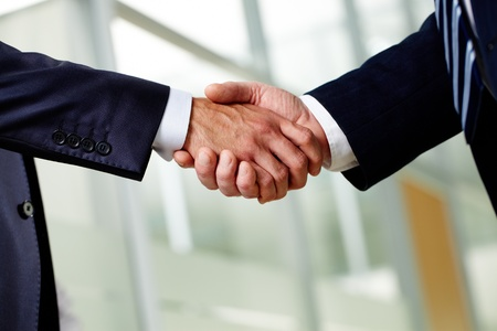Senior businessman shaking hands as a sign of a successfully concluded deal