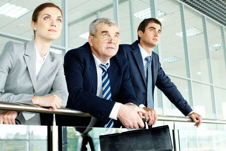 Business team looking confidently in future