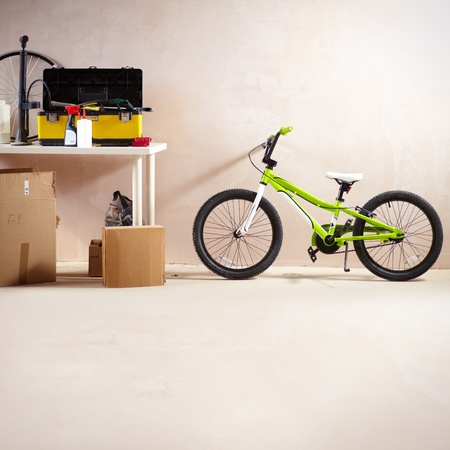 Image of mountain bike and some equipment in garage