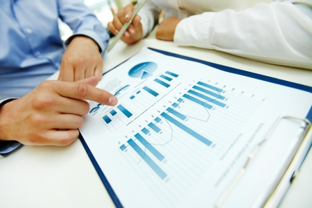Close-up of graphs and charts analyzed by business people