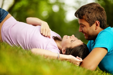Happy guy and girl spending time together in park enjoying each other's company