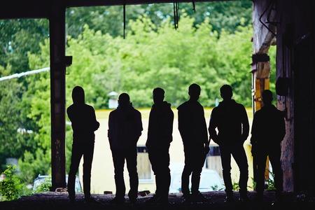 Outlines of gangster team outside