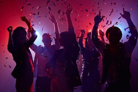 Party people having fun in nightclub