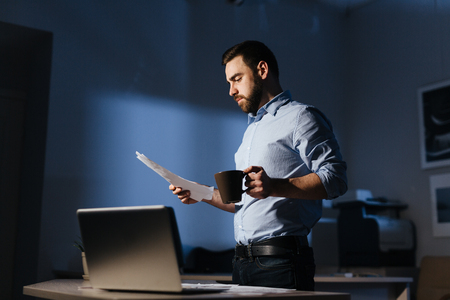 Businessman Working with Documents Late at Night