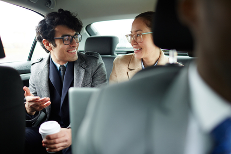 Business people Chatting in Backseat of Car