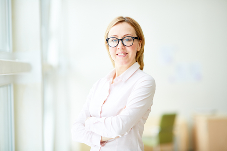 Successful adult woman in glasses