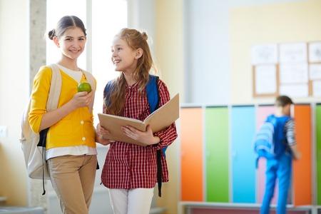 Positive elementary students in corridor