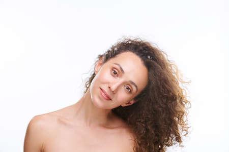 Photo pour Young gorgeous woman with dark long wavy hair bending her head on the left - image libre de droit