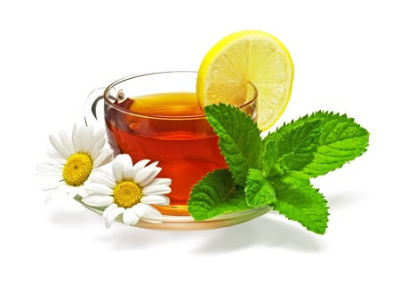 tea in cup with leaf mint, lemon and chamomile