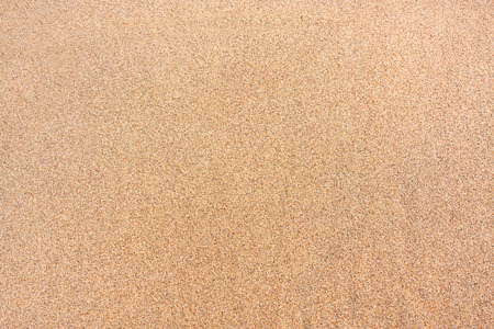 Foto de Textured wet sand background - Imagen libre de derechos