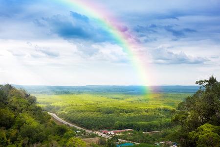 Photo pour beautiful landscape with cloudy blue sky and rainbow - image libre de droit