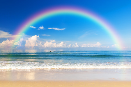 Beautiful sea with a rainbow in the sky. Karon beach, Phuket, Thailand. Asia
