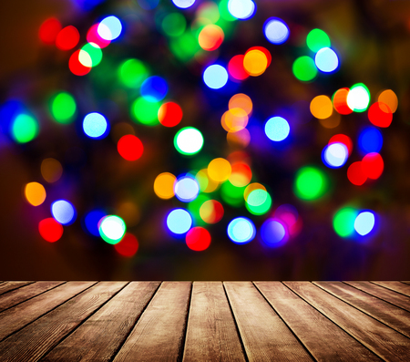 Photo pour Empty wooden table in front of abstract blurred background with light spots and bokeh. Multicolor abstract bokeh background. - image libre de droit