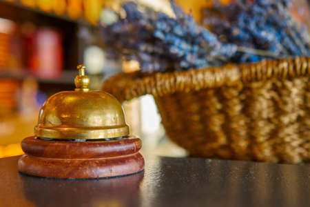 Photo pour A service iron bell in a hotel on a wooden table - image libre de droit