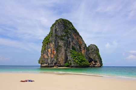 This is Ao Tham Phra Nang Beach.It a perfect beach that attracts thousands of visitors year round but is able to maintain its flawless appearance and relaxing ambience. Although these attractions are accessible only by boat, they still draw numerous visit